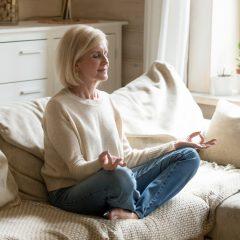 https://www.glenviewterrace.com/wp-content/uploads/2021/04/PHOTO-Shutterstock-GT-2021-MANAGING-STRESS-Woman-on-Couch-Crosslegged-Meditating-Yoga-240x240.jpg